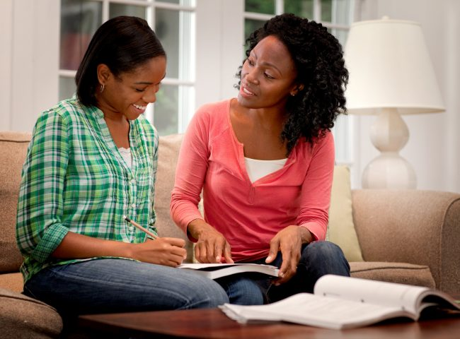 mother helping daughter with scholarships