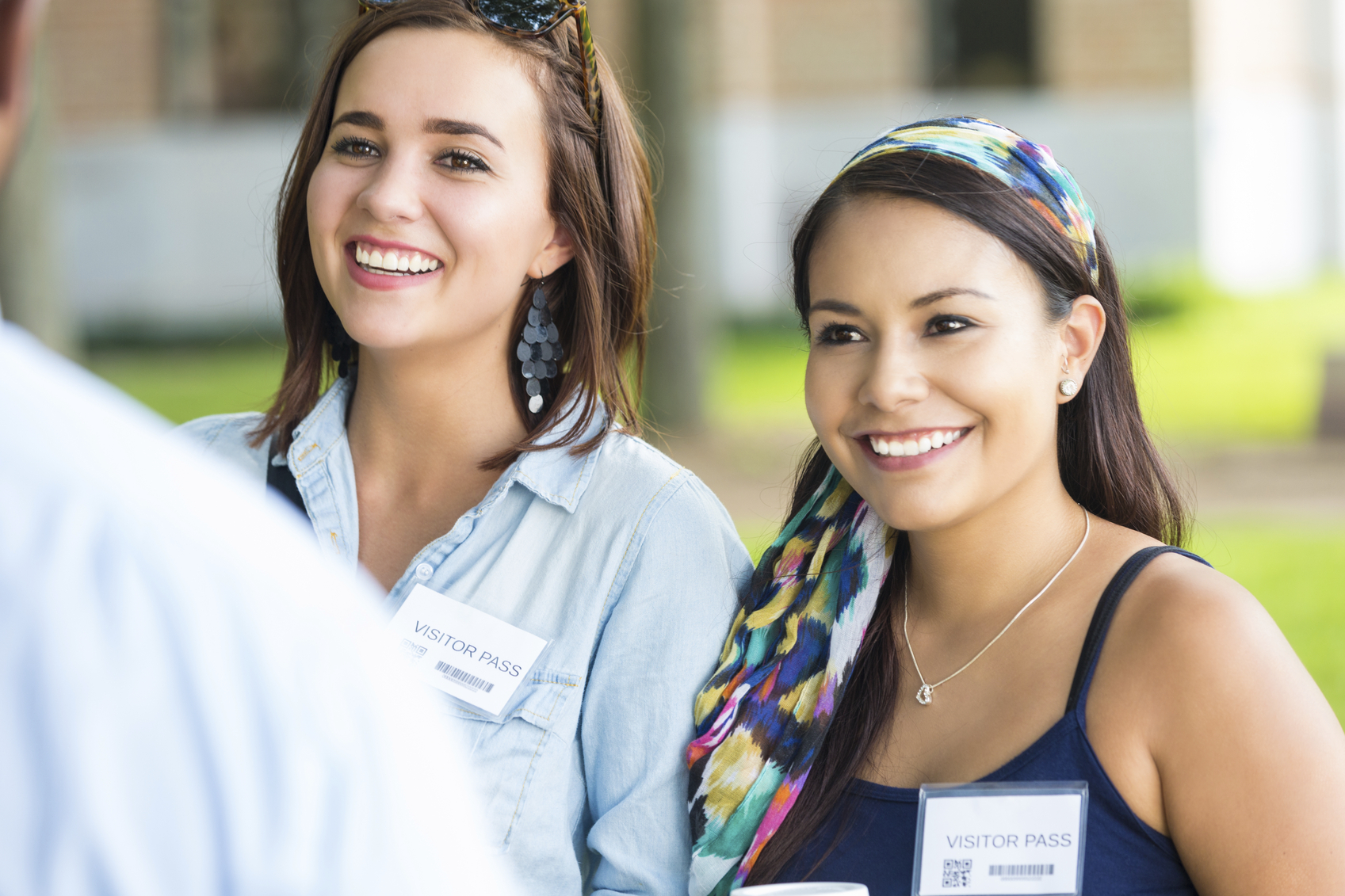 Young women touring beautiful college campus with tour guide