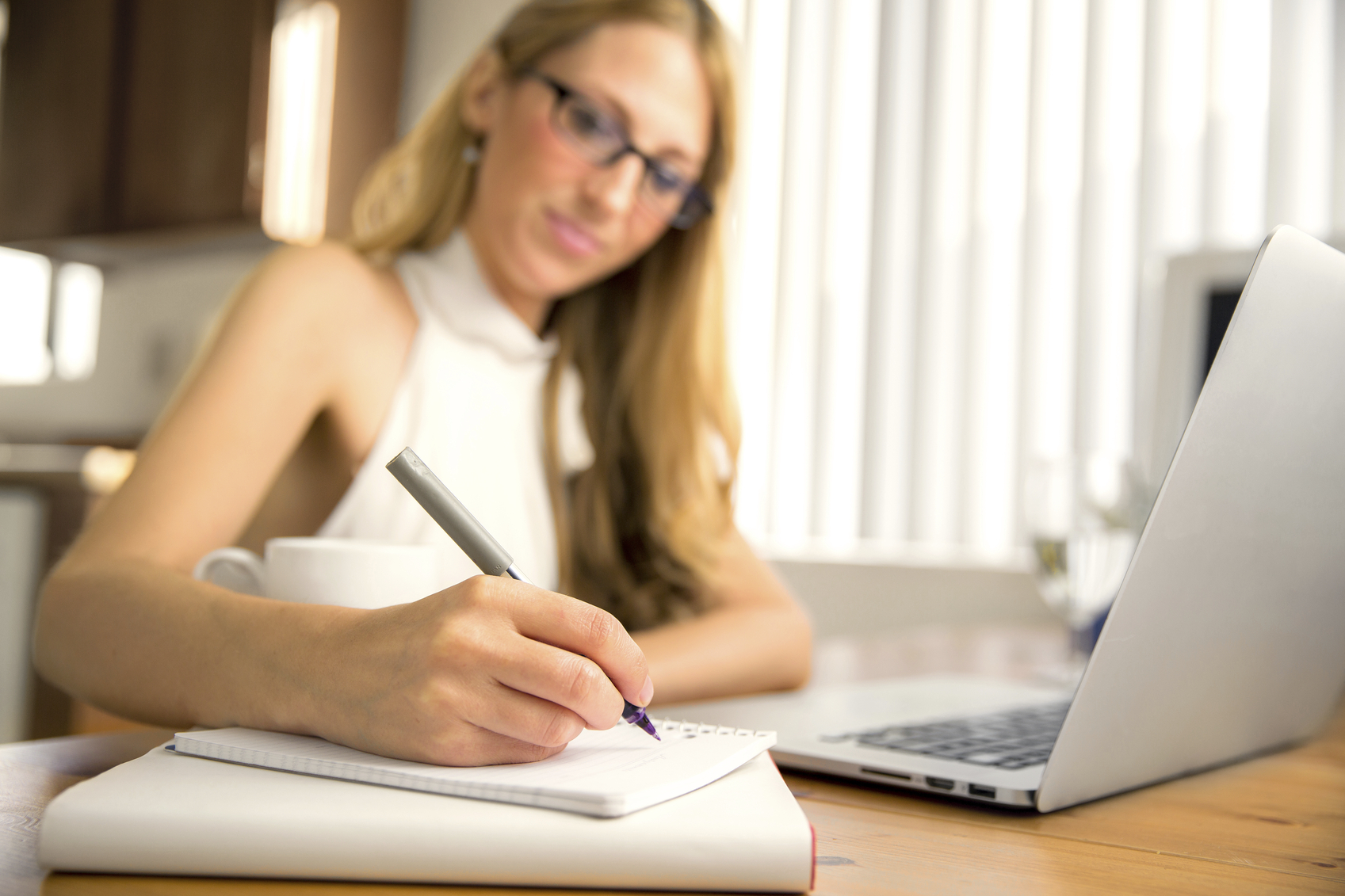 Woman out of focus writing note
