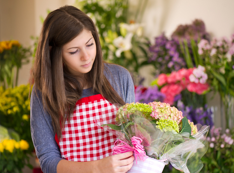 Student working at flower shop over summer