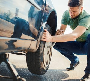 changing tire as an emergency expenses pops up