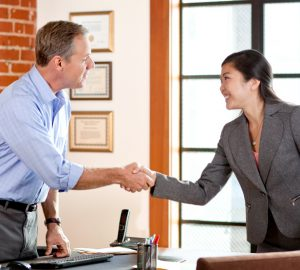 College student negotiating first salary, shaking hands