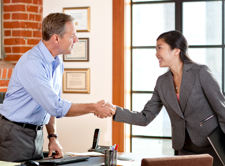 College Student Negotiating First Salary Shaking Hands