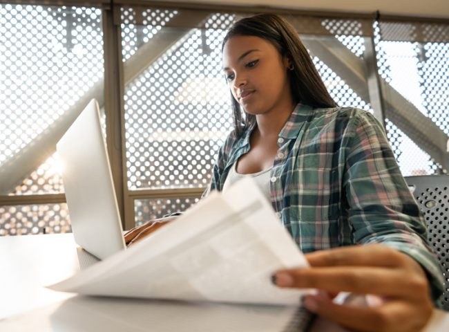 A student compares financial aid offers