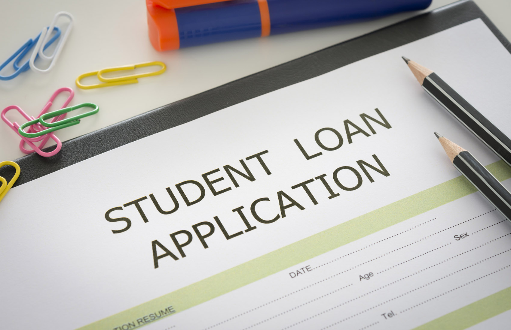 Student loan application form on desk with stationery