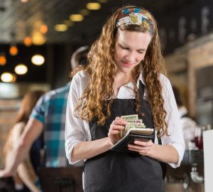 student waitress counting tips over summer break