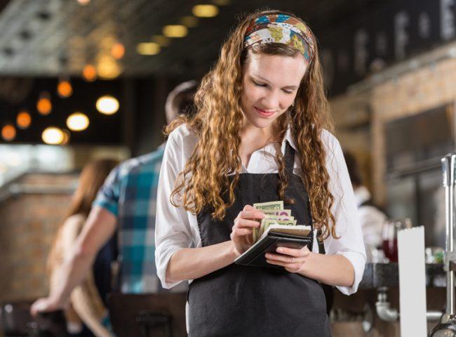 student waitress counting tips over summer break