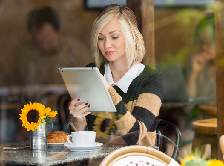 Young woman reviewing unexpected expenses on her tablet