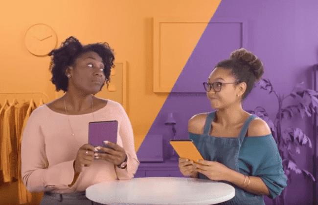 Two young women discuss saving goals.