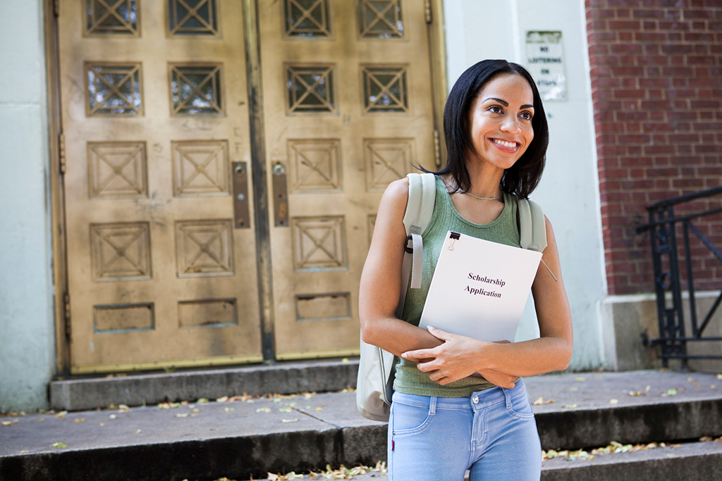 Woman with scholarship application