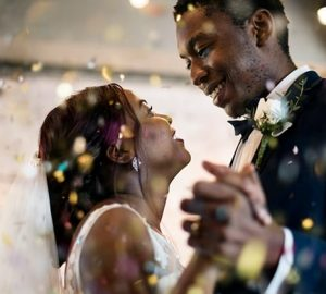 A young couple dances on their wedding day.