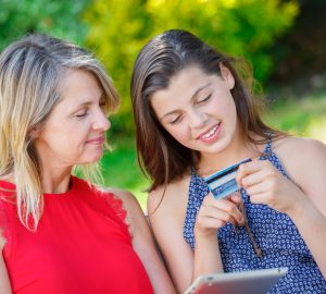 Mother and daughter looking at daughter's first credit card