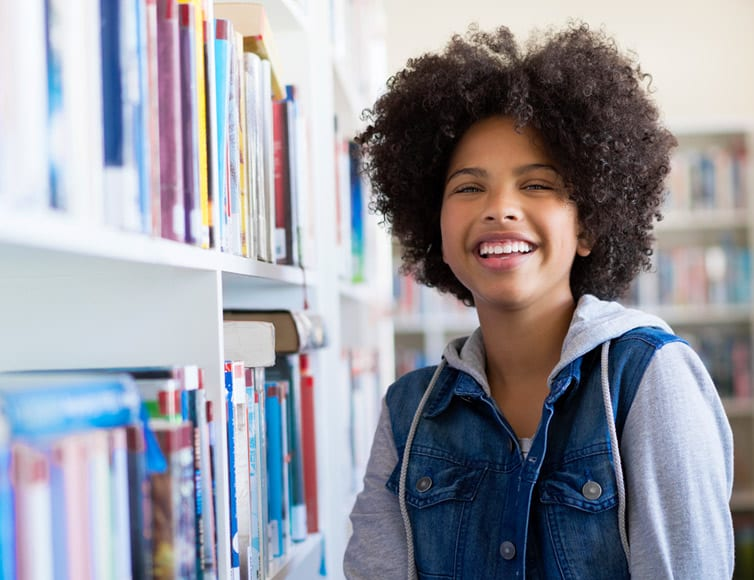 student in library planning for college