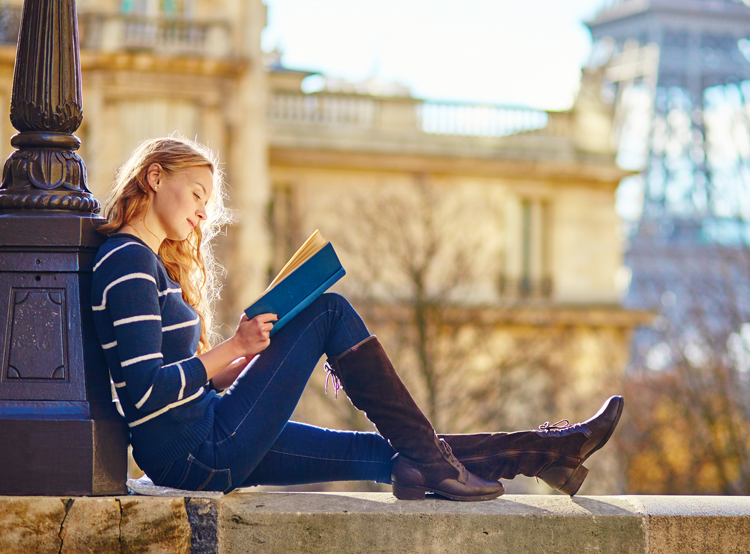 student on study abroad reading book
