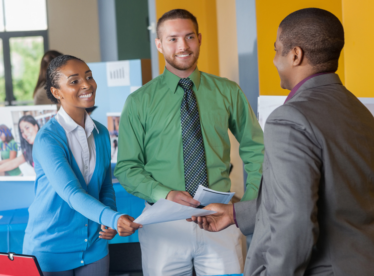 Students attending career fairs and handing out resume