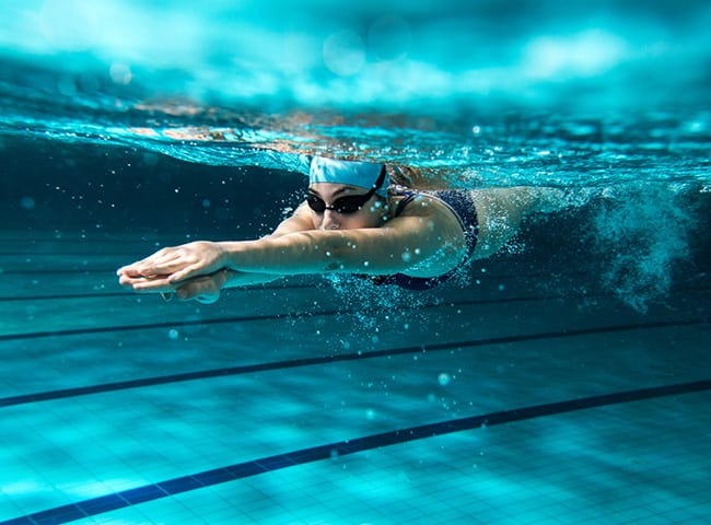 A woman swims in a pool.