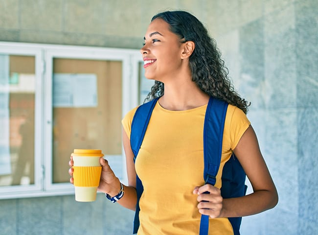 Student with coffee and backpack
