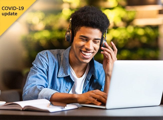 A student smiles during a videoconference.
