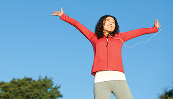 Woman jumping with headphones