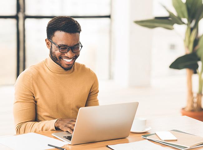 A student uses a laptop for a virtual career fair.