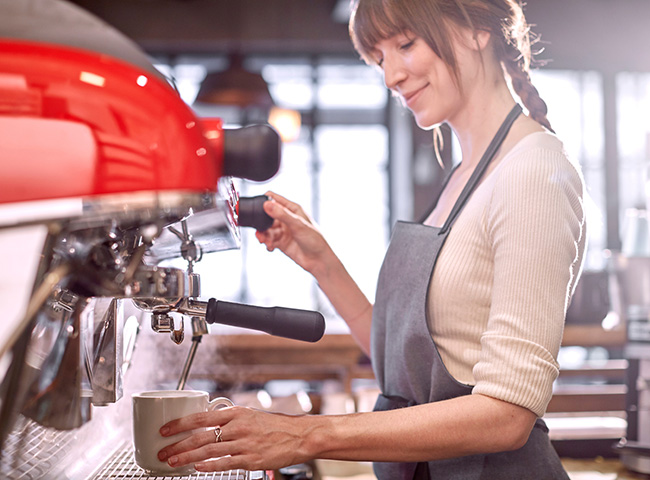 A student learns how to pay off student loans by working as a barista.