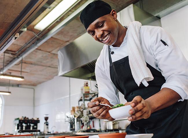 Man prepares food in a kitchen